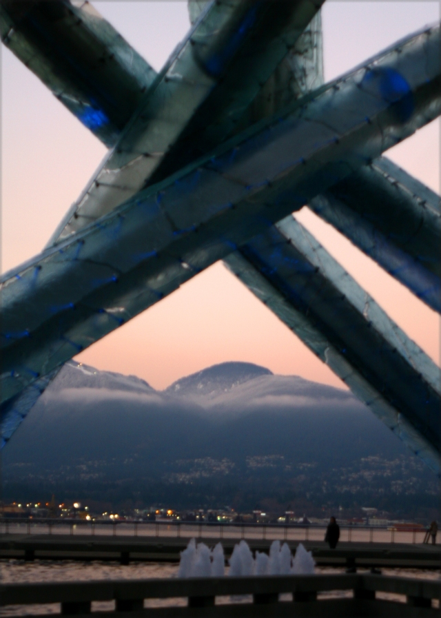 Olympic sclupture and Mtns in background