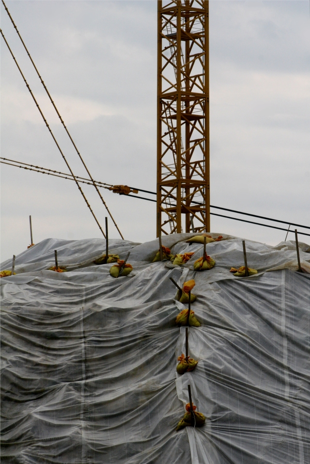 Crane and mound of earth, new Viking construction site