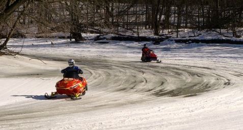 Snowmobiling on slushy Rum River