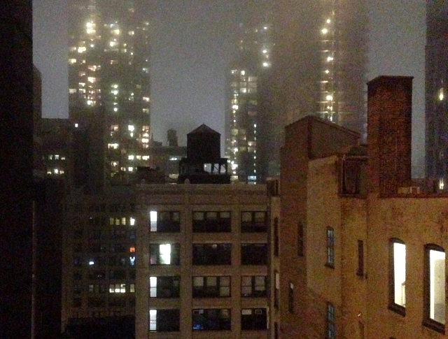 Moody Manhattan with water tower from Hotel room