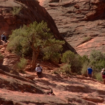 Hikers going towards top of Cathedral Rocks formation 002