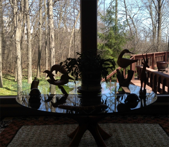 reflections-of-wood-art-on-glass-table-parents-house
